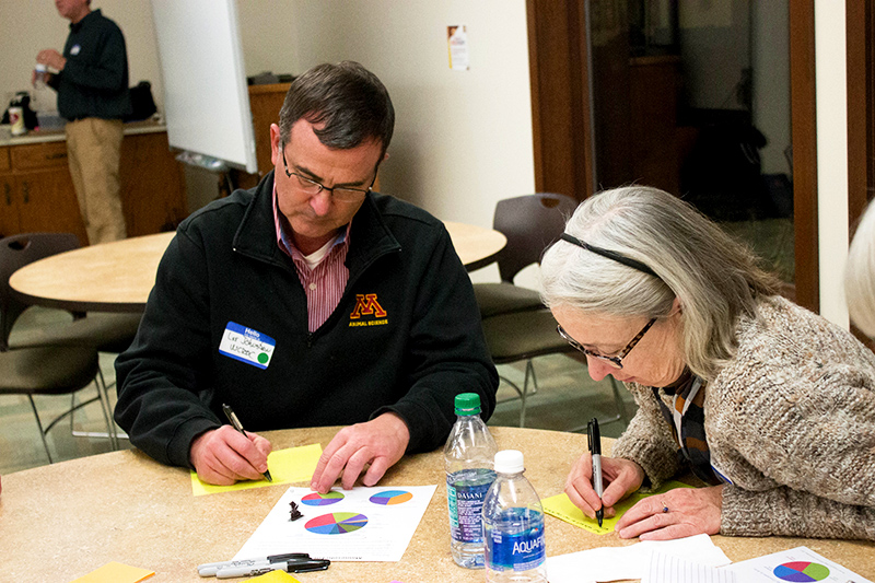 "Residents of Stevens County write down questions during the ""Our Energy Future"" event."